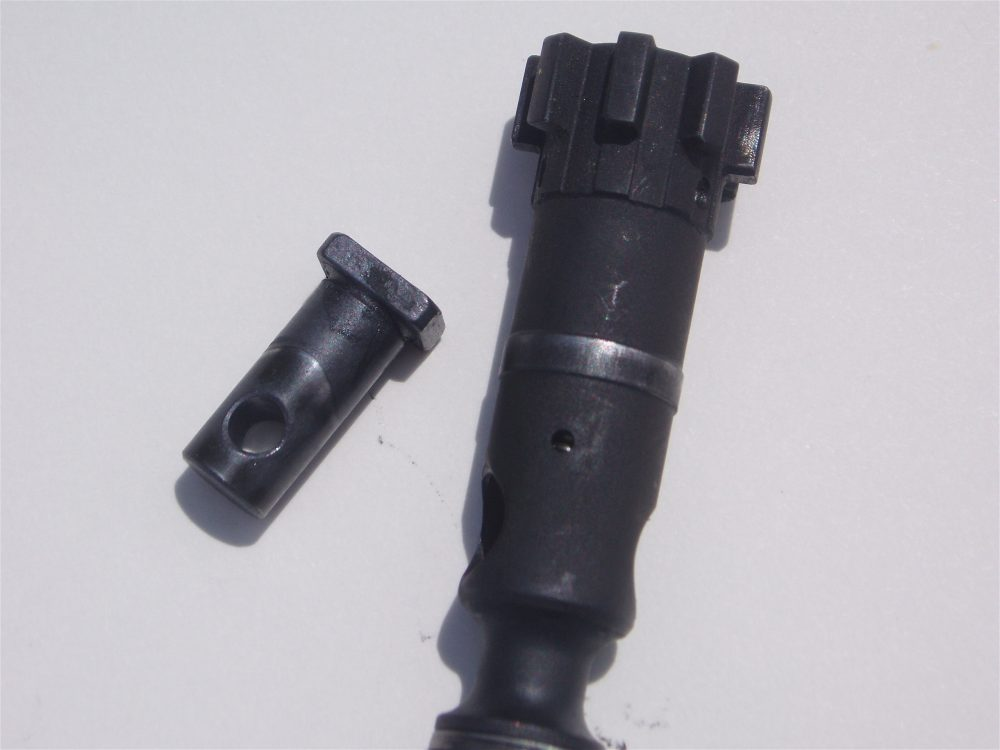 Wear on body of bolt and bolt cam pin.