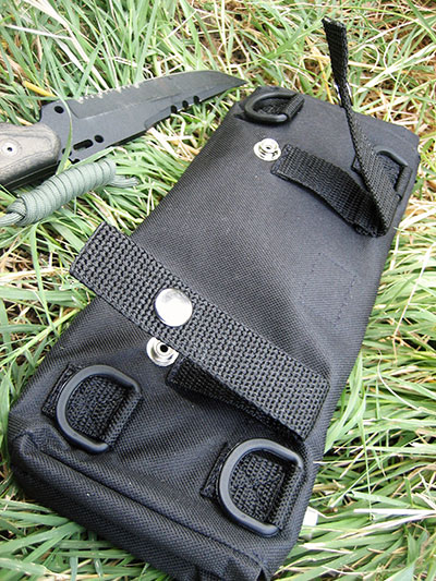 BOB has several options to attach it to a belt, other packs, or vehicles. Snap loops and heavy-duty plastic D-rings are featured on back of bag.