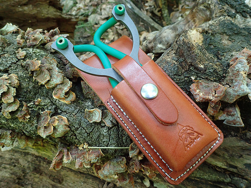 TOPS Slingshot includes quality leather sheath with generous belt loop on the back. Simple snap closure keeps sling secure yet deploys quickly.