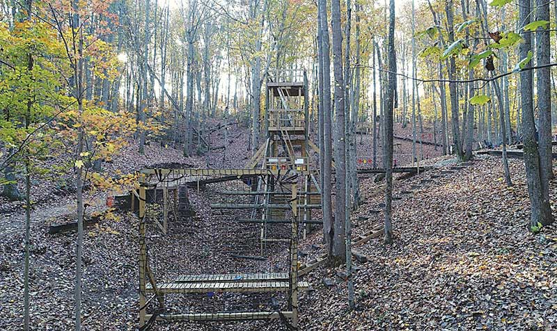 Overview from start point of live-fire obstacle course. Center of fire and movement complex is 40-foot tower. Advance is all uphill. Course is peppered with obstacles plus manmade and natural cover.