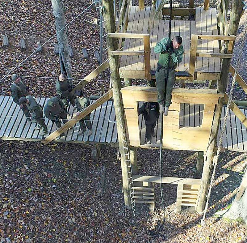 Charles County EST member fast ropes from 40-foot multi-purpose tower.
