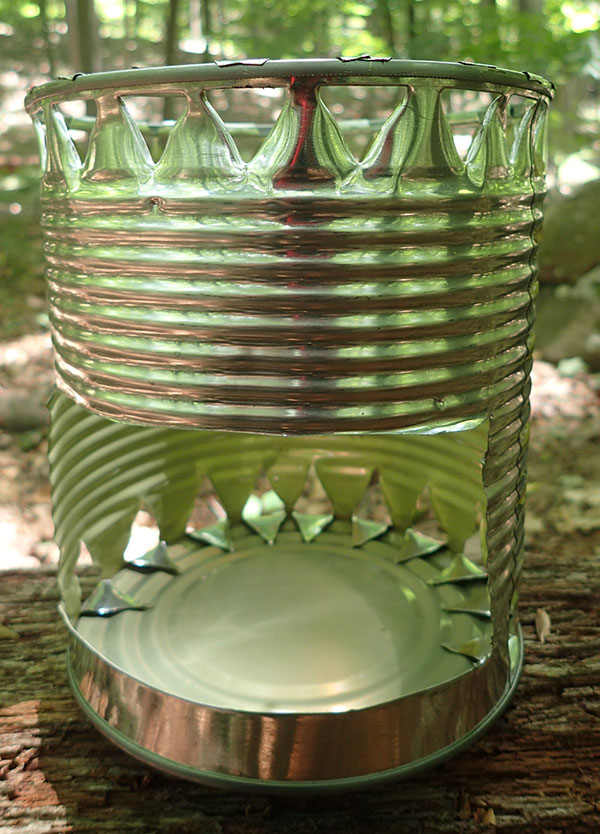 Hobo stove made from large string-bean can using tin snips, can opener, and Swiss Army knife awl.