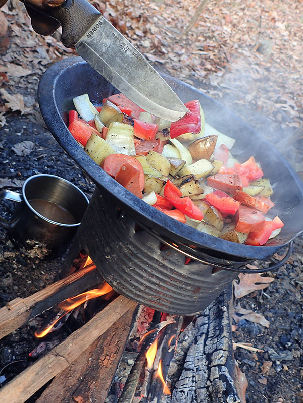 Frying pan can be placed on top of hobo stove without any support grill. Fuel doesn't need to be cut to size because it is slid inside lengthwise.