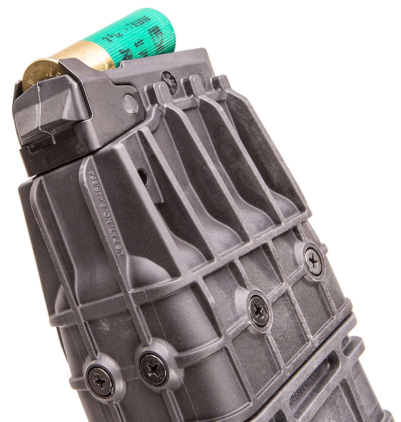 Rear of mag shows hardened steel feed lips and over-molded steel shell ramps.