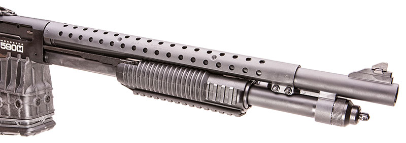 Ventilated heat shield runs from front of the receiver and extends past the forend.
