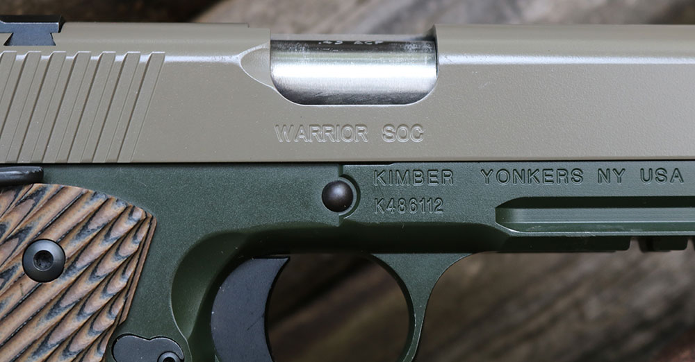 Lowered and flared ejection port of Kimber Warrior SOC TFS spits empties out away from the shooter.