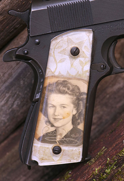 This particular GI 1911A1 includes a priceless right grip crafted by hand and carried by Dabbs' grandfather-in-law, a decorated WWII Infantryman. He carried this photograph of his young bride through combat in North Africa, Sicily, and Italy.