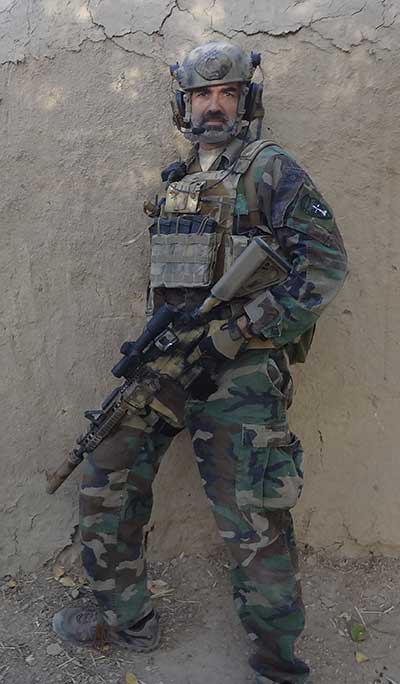 Author in Afghanistan, 2015. M4A1 outfitted with Trijicon VCOG, BCM GUNFIGHTER grip, Ark Defense buttstock, Magpul AFG, offset mini-red dot, and Arredondo extended mag well.