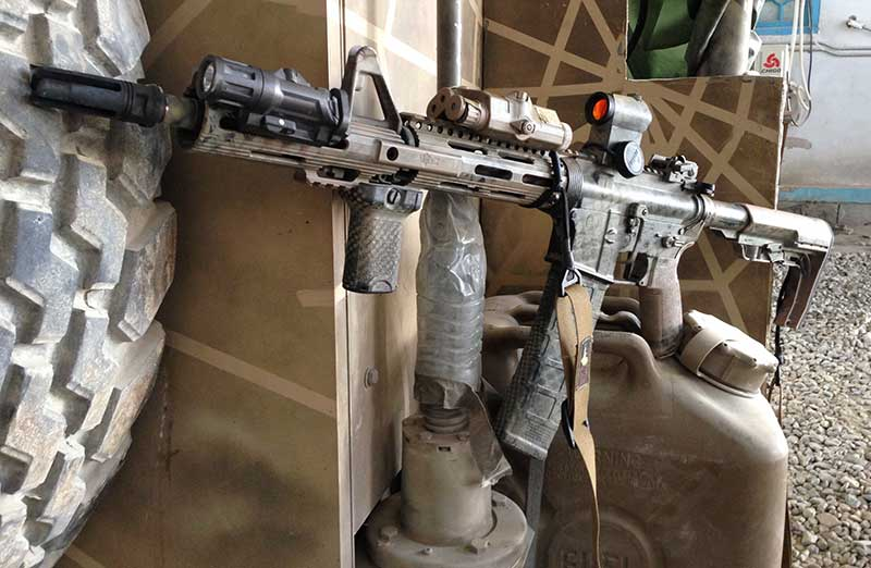 Author's teammate's customized M4A1 from Afghanistan tour was featured in TACTICAL CARBINE PART II: Foregrips, Lights, and Lasers, April 2015 S.W.A.T.