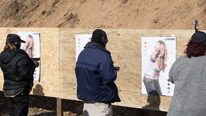 After technique is demonstrated, class practices close-in shooting.