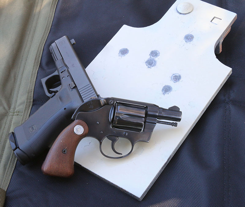 Third handicap is to offset the hands by platform. Strong hand gets the back-up gun, like this vintage Colt Detective Special. Support side gets the full-size piece. Splatters on Noner target show impacts from Black Hills wadcutters from single shots at distance under time pressure.