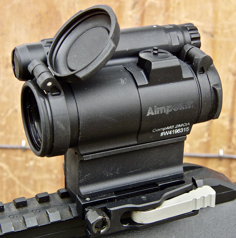 Left-side view of CompM5 with lens cover up. Throw lever mount is visible.