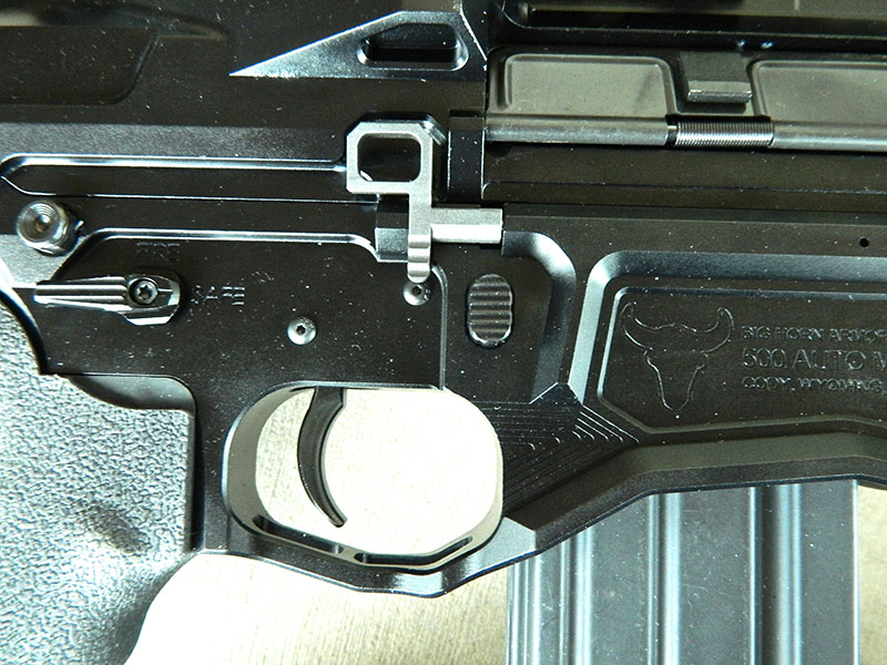 Right side of receiver shows ambidextrous bolt release and safety. Rifle features enlarged trigger guard.