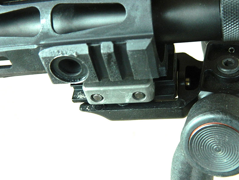 Short rail segments at three, six, and nine o'clock at muzzle end of handguard can be used to attach lights, lasers, bipod, etc.