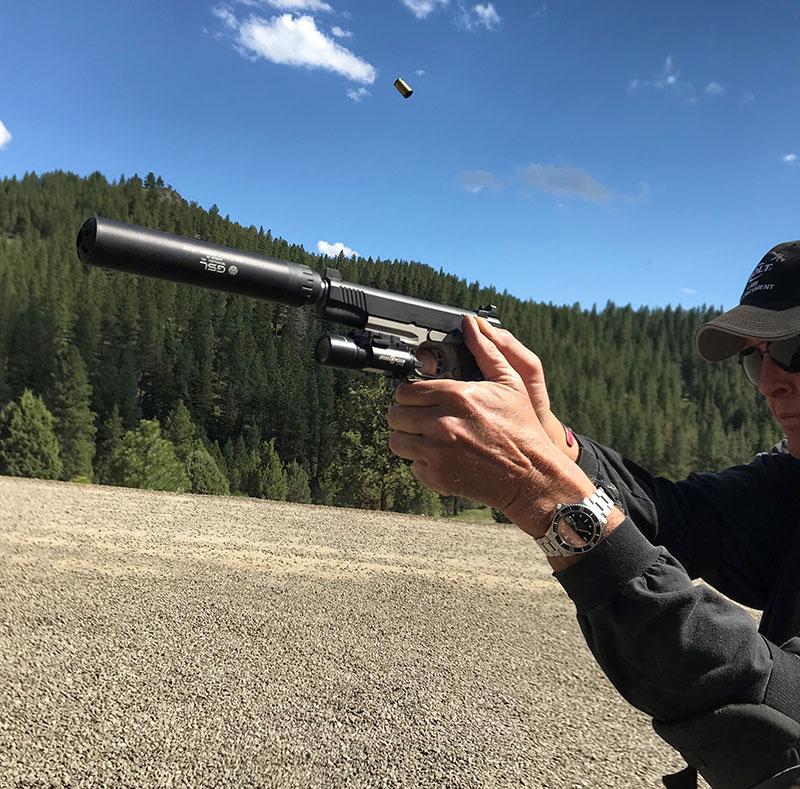 Author shoots Colt Rail gun with Python suppressor at Thunder Ranch.