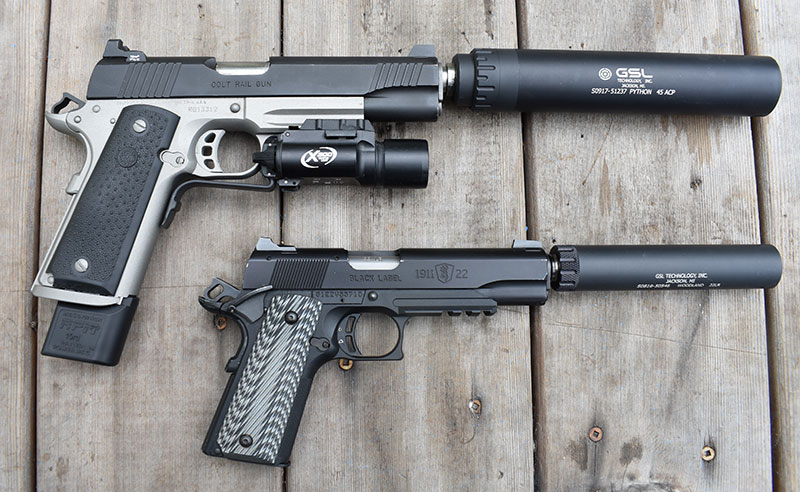 Colt .45 Rail Gun and Browning Black Label .22 with suppressors attached.