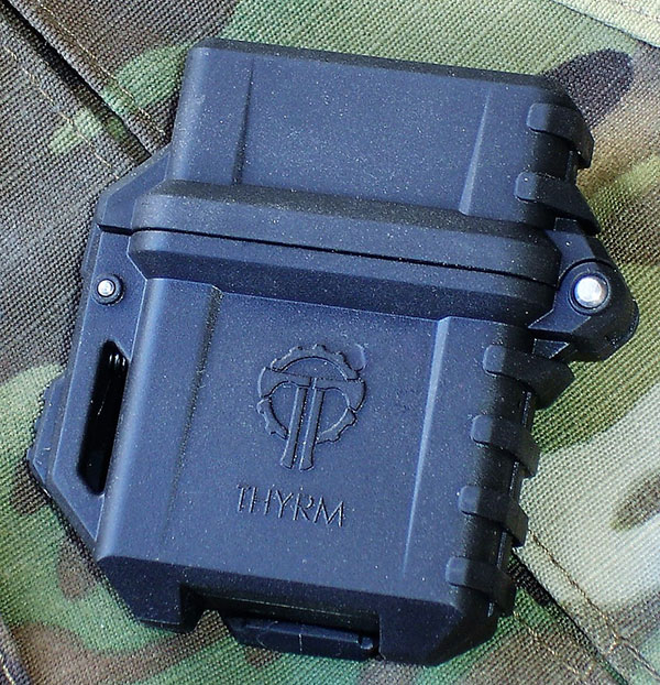 """Thyrm PyroVault is designed to """"up-armor"""" the classic Zippo lighter for outdoor and survival applications. It's made of rugged polymer and is PALS/MOLLE compatible."""