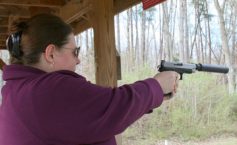 """Members of author's shooting club enjoyed launching """"quiet"""" bullets with SIG Sauer P226 pistol. They felt less intimidated when muzzle blast was reduced."""