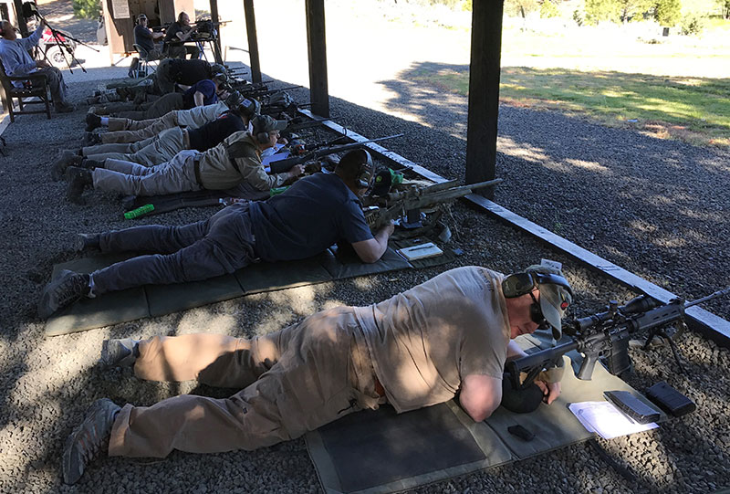 On the firing line at Thunder Ranch. Clint Smith is seated at top left.