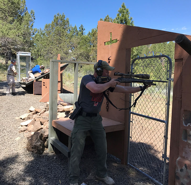 Lt. Rob Boothe shoots his old sniper rifle.