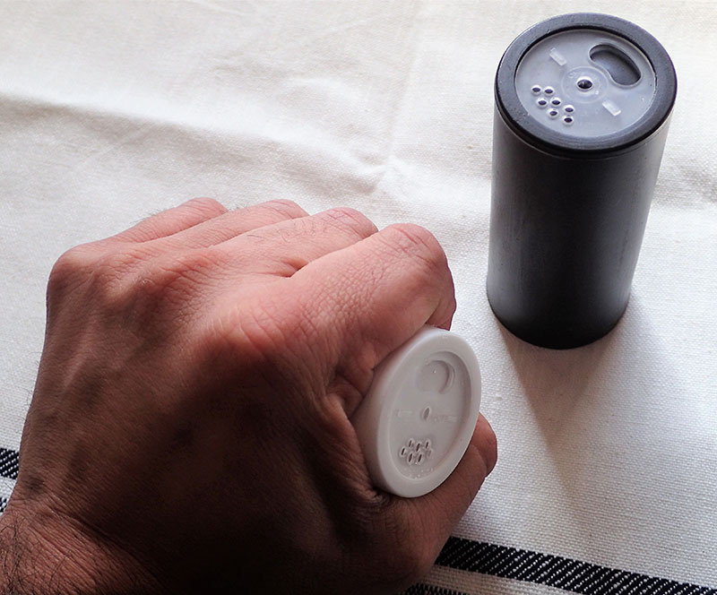 Salt shaker can be used in a hammer-fist technique, or you can open the shaker and splash salt in the attacker's eyes.
