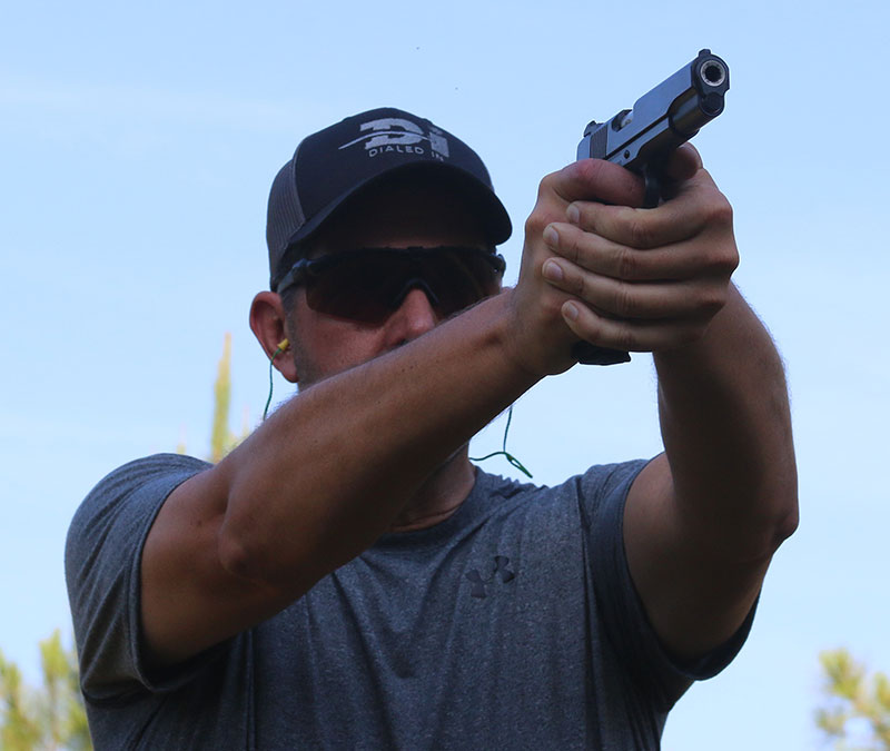 The handgun can be a capable tool at distance with the right training approach.
