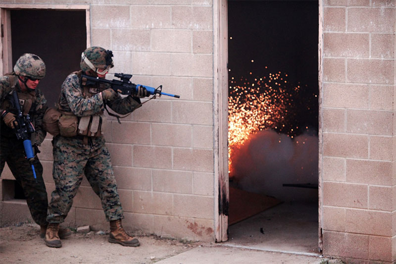Marine fire team with 2nd Battalion, 1st Marines deploys flashbang prior to entering building. Special Operations Training Group organized flashbang training to boost Marines' confidence before deployment. Photo: U.S. Marine Corps photo by Lance Cpl. Joshua Murray / Released