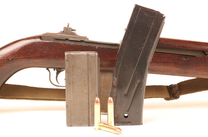 M1 Carbine fed from either 15- or 30-round box magazines. Thirty-round mags showed up at very end of WWII.