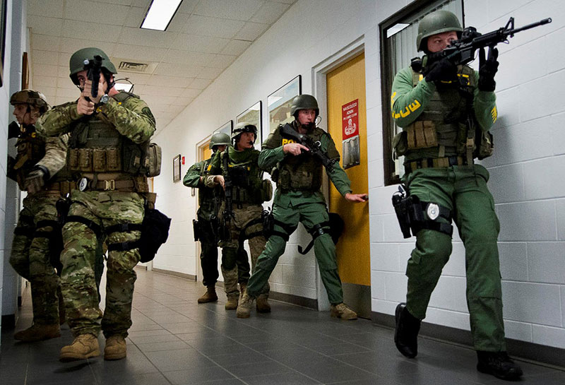 Own the hall, own the floor. Law enforcement team posts two officers covering long down the hall to ensure no bad guys have a chance to shoot at the entry teams from rooms that have yet to be cleared. Photo: courtesy DOD