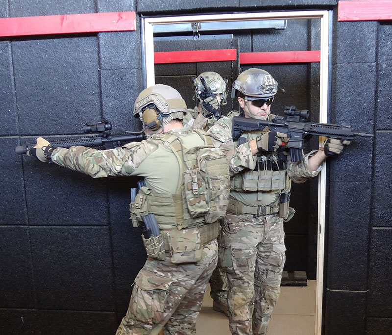 From the enemy's point of view: No matter how tight the stack is, when the number one and two man are clearing corners first, there is a gap in coverage where, if threats are in the center of the room, they have a chance to shoot at the number one and two man before the number three and four man enter and engage them.