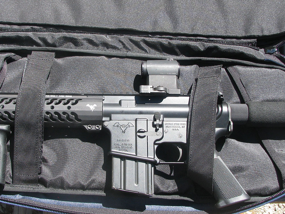 Velcro straps hold gun, magazine, and optic securely in SneakyBag.