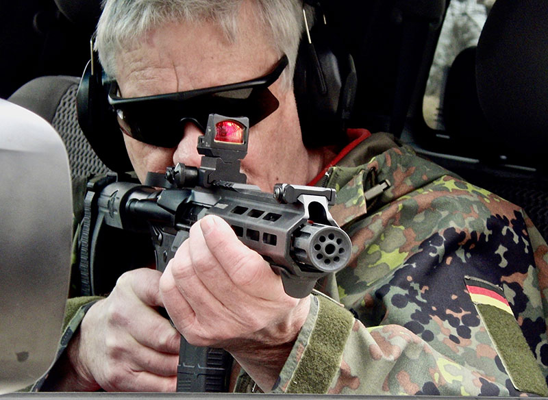 Thompson trains with Springfield Armory SAINT for deployment from within a vehicle. Blast diverter is useful in keeping blast away from the shooter. With the short barrel, blast would be especially noticeable within a vehicle.