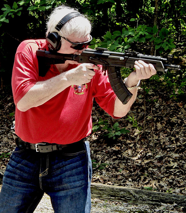 Thompson shoots C39v2 Blade. Blood on his trigger finger is from firing string of shots rapidly and banging finger against either the trigger guard or receiver.