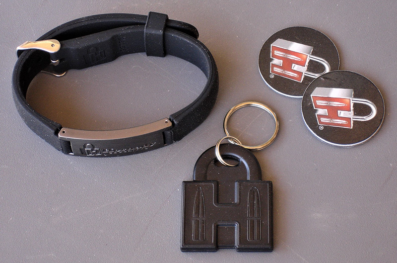 """RFID unlocking system on Hornady RAPiD Vehicle Safe can be triggered through included RFID-enabled tags specifically programmed for each safe. RAPiD Vehicle Safe also comes with RFID Adjustable Wristband, RFID """"H"""" Key Fob, and two RFID Adhesive Decals."""