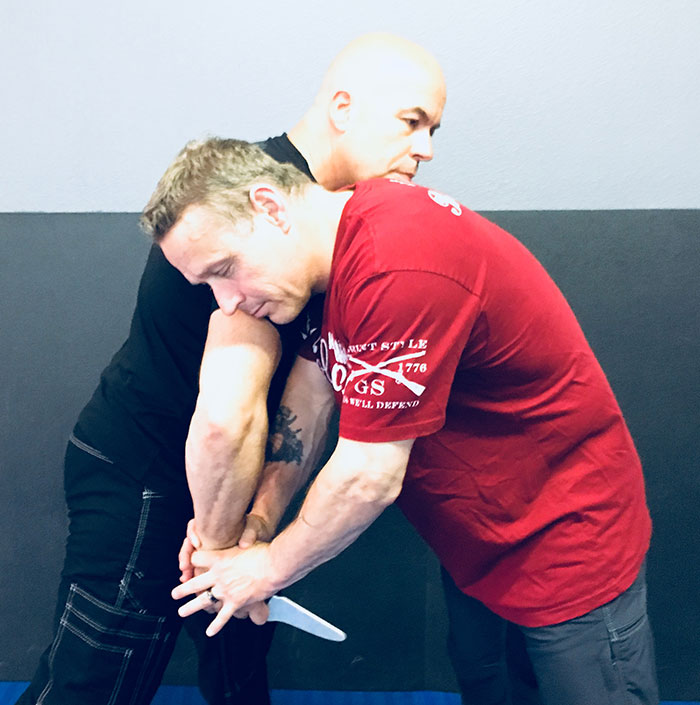 Hill Country Combatives owner and chief instructor Cliff Byerly (a certified Red Zone Knife Defense instructor) uses combination of Position, Pressure, and Angle to isolate and immobilize attacker's weapon-bearing arm and set up his next move. This should be done prior to any attempt to break contact, throw attacker to the ground, or draw a handgun.