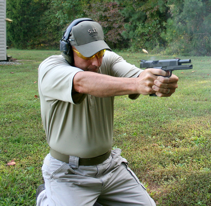 Former FAM Ken Trice drops to double kneeling position and hammers target with multiple rounds. Recoil's absorbing weight facilitated low split times for double taps and hammers. Little effort was required to bring muzzle back down from muzzle rise.