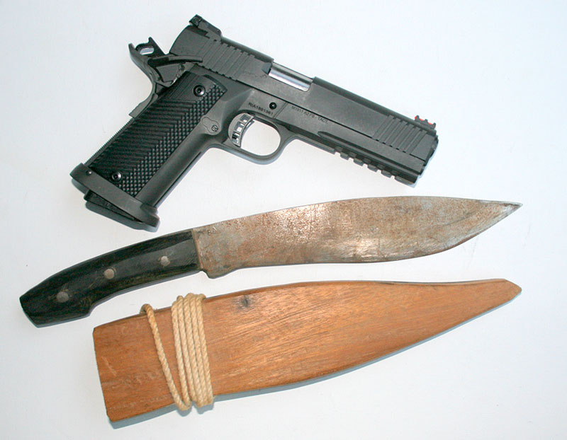 Tac Ultra FS HC pistol with author's bolo knife. Made by a Negrito at a Philippine Jungle Survival School from auto leaf spring, author used it in Vietnam.