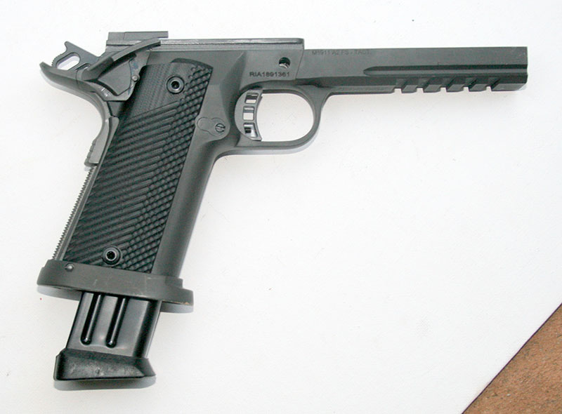 TUFSHC receiver is cast 4140 steel and features full-length dustcover with Picatinny rail. G10 grips, backstrap checkering, and raised beavertail grip safety contribute to good ergonomics and overall control of the pistol.