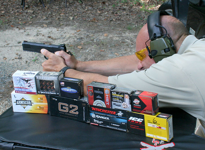 Former FAM Ken Trice fires 25-yard groups from handheld rest. Ammo in foreground was used for evaluation.