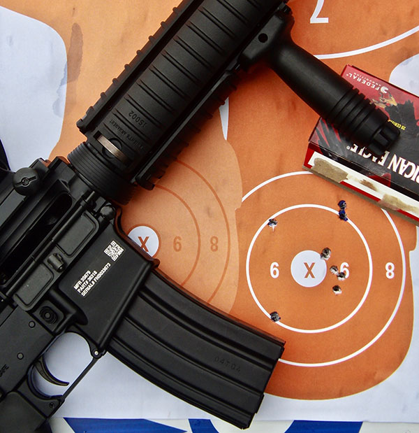 Four 50-yard double taps fired with Military Collector M4.