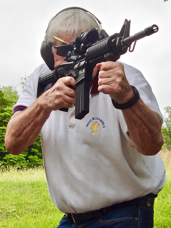 Thompson fires FN 15 Military Collector M4 at hanging plates at 50 yards.
