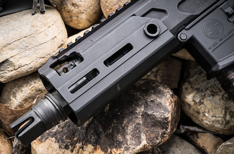 MCX Rattler features free-floating M-LOK handguards matched with a PDW upper with 5.5-inch barrel. Barrel shown with optional SIG Taper-Lok fast-attach muzzle device for SIG suppressors. Two-position adjustable gas regulator is visible in window in handguard.