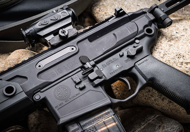 MCX Rattler features PDW upper paired with MCX VIRTUS lower. All controls on MCX Rattler are fully ambidextrous. It has SIG Matchlite Duo trigger. Gun here has Magpul K2 grip. SIG has subsequently come out with its own grip for MCX Rattler.