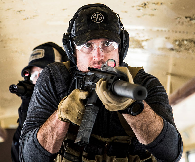 Individuals with suppressed MCX Rattler SBRs during tubular assault training. MCX Rattler is ideal for fast-moving operators in close quarters.