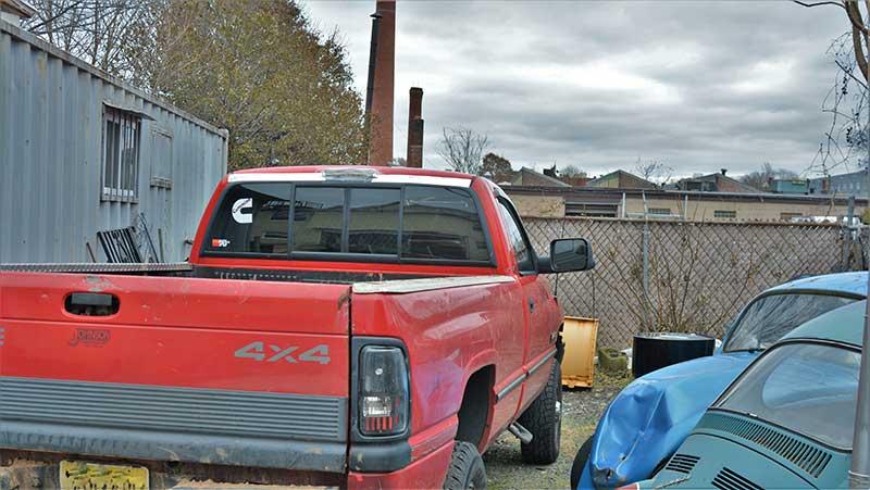Small auto shop dump makes perfect inconspicuous campsite.