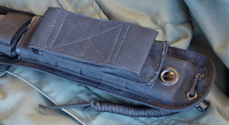 Optional Velcro Hogue Modular MOLLE Pouch attaches to sheath or any MOLLE-compatible gear.
