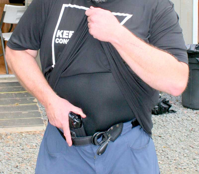 Keepers demos grip on pistol carried AIWB. Support hand lifts cover garment as high as possible to chin. Undergarment is smooth and reduces drag during draw.