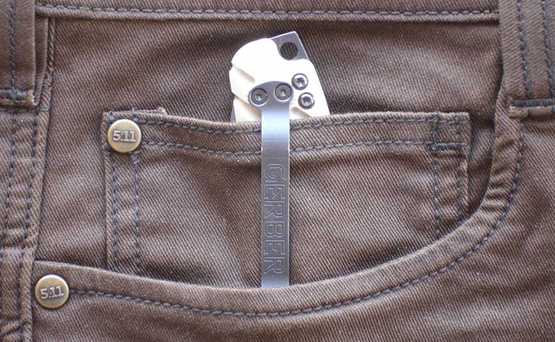 Gerber Propel Auto in right-side coin pocket on men's Defender-Flex Pants.
