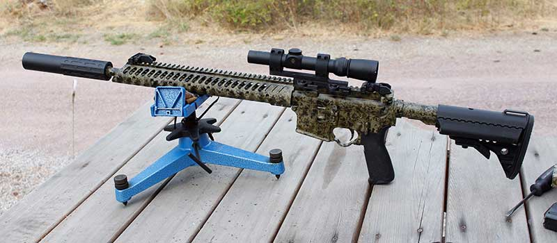 Colt with .300 upper, Leupold scope, and Gemtech One suppressor.