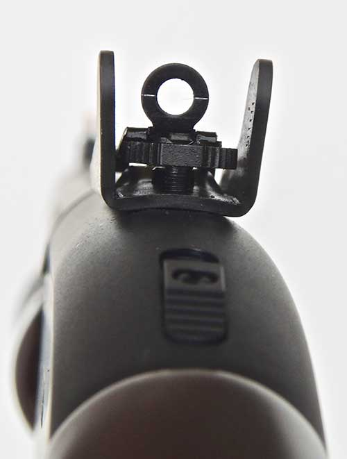 Ghost-ring sight is open enough for fast use with buckshot but still allows some precision for slugs. Wings protect the sight.